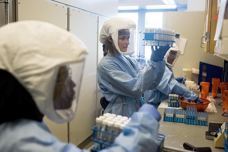 Coronavirus samples for genomic sequencing being unpacked in the Bonsignori Lab of Duke University in Durham, N.C., US