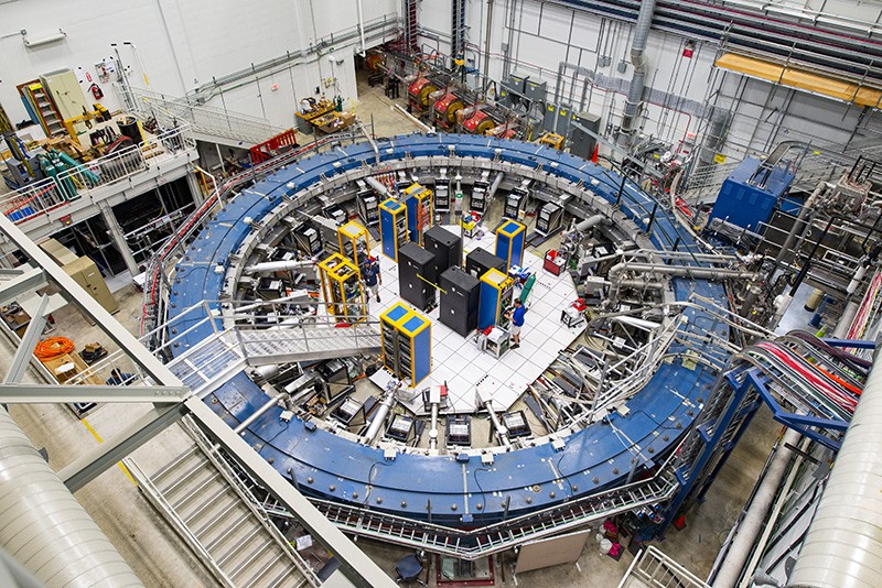 The Muon g-2 ring sits in its detector hall amidst other equipment