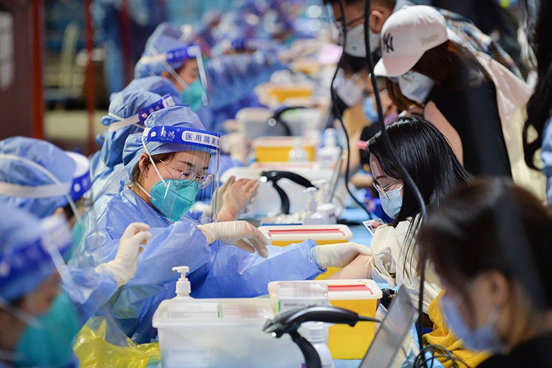 Students receive COVID-19 vaccines at the Khoo Teck Puat Gymnasium of Peking University on March 28, 2021 in Beijing, China.