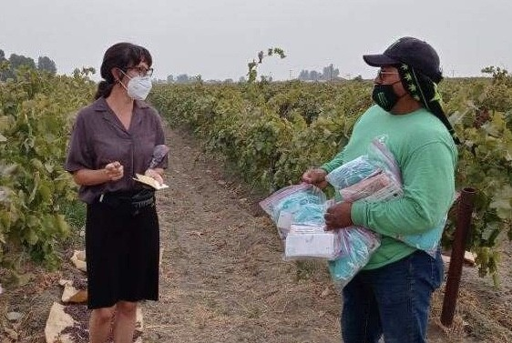 Nature reporter Amy Msxmen interviews an agricultural worker in California.