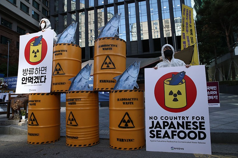 South Korean environmentalists stage a rally in front of Japanese embassy in Seoul.