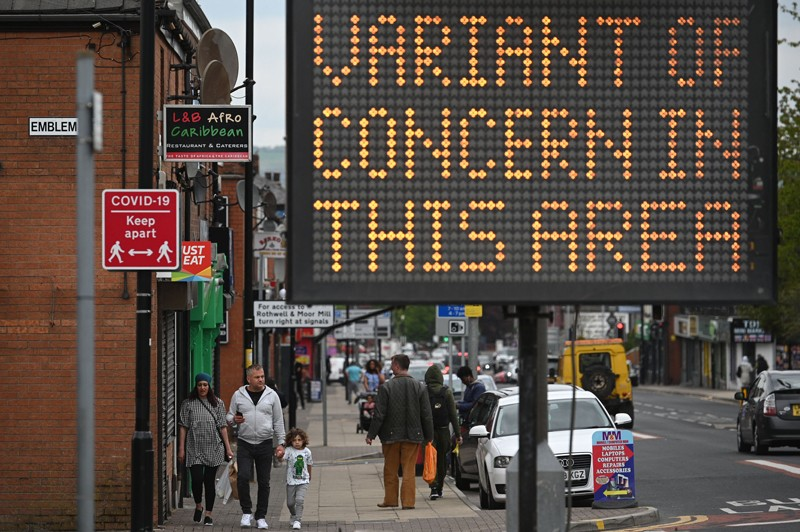 A digital board warns the public of a COVID-19 variant of concern affecting the community.