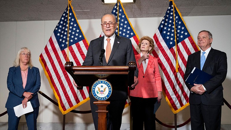 Senate Majority Leader Chuck Schumer speaking at a press conference in Washington, DC.