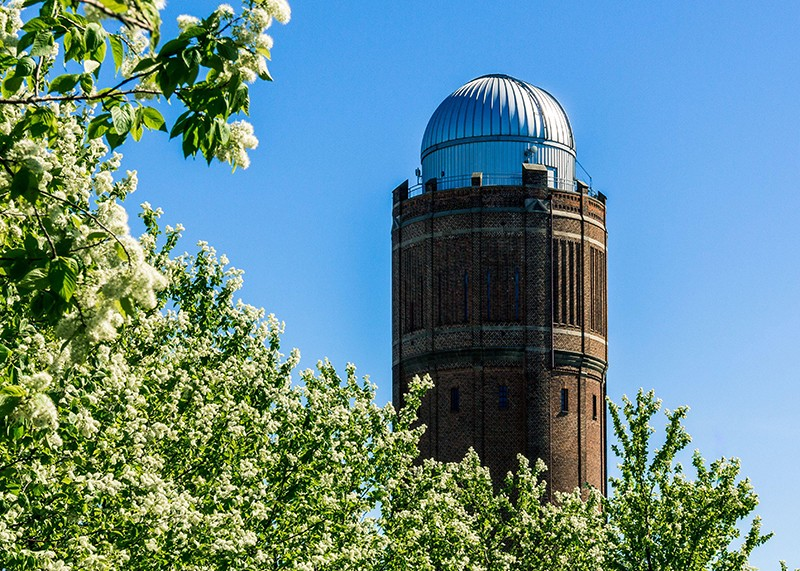 The old observatory with the growth of trees in spring.