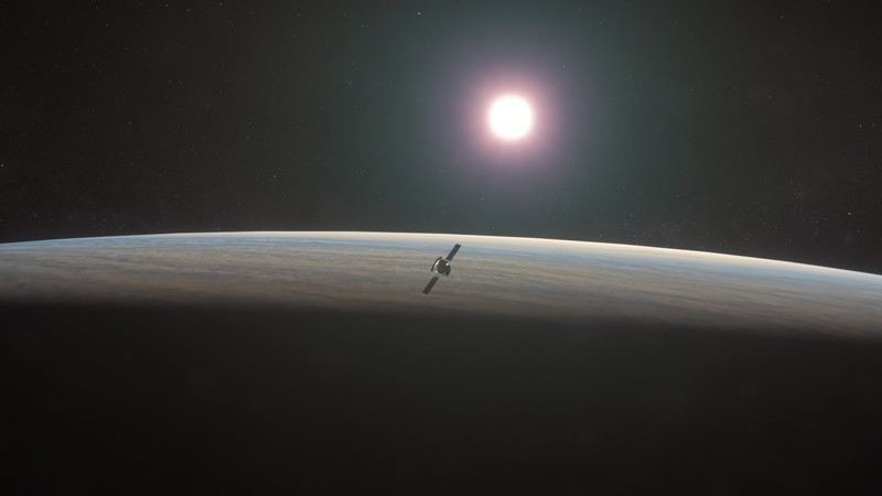 An artist's impression of the EnVision spacecraft orbiting around Venus with the sun in the distance