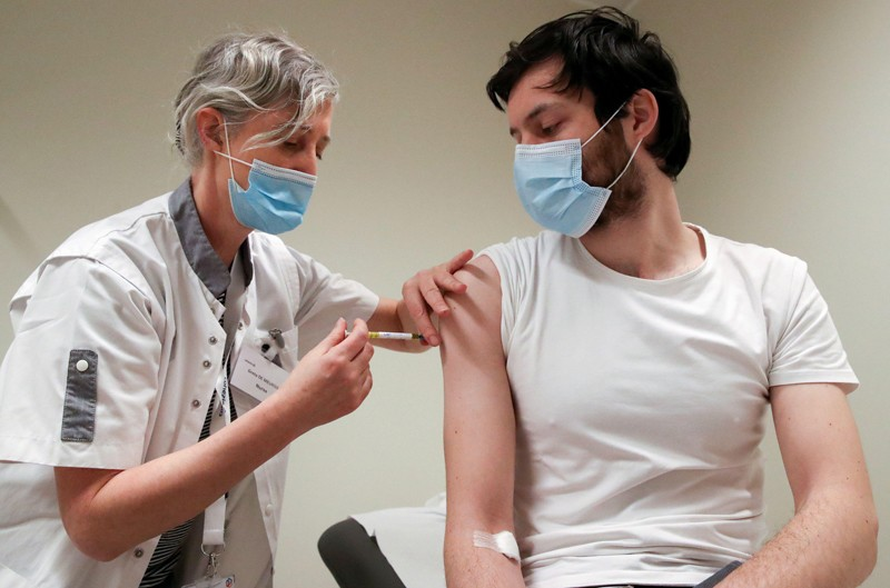 A volunteer is given an injection during CureVac clinical trial in Brussels, Belgium