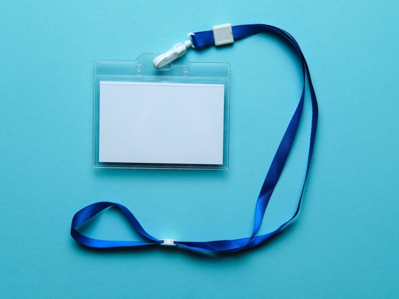 Security Badge on colorful background, event invitation concept, job.