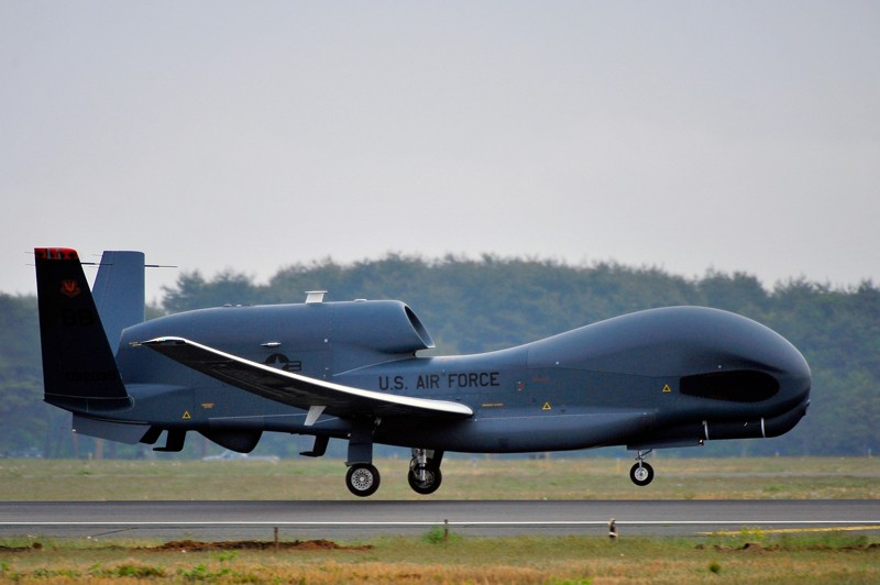 A US Air Force RQ-4 Global Hawk unmanned aerial drone lands on a runway