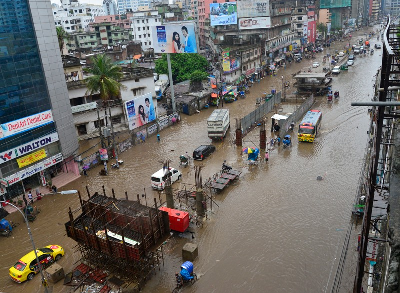 Flooded streets of Dhaka after heavy rainfalls caused a standstill in the streets to vehicles and commerce in Bangladesh.