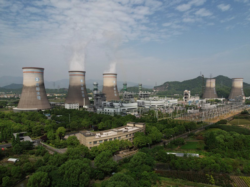 Steam billows out of chimneys of a coal-fired power plant in Hangzhou in east China' s Zhejiang province.
