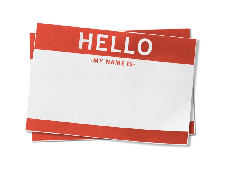 """Stack of two red name badges with the words, """"HELLO, my name is"""" printed in big letters."""