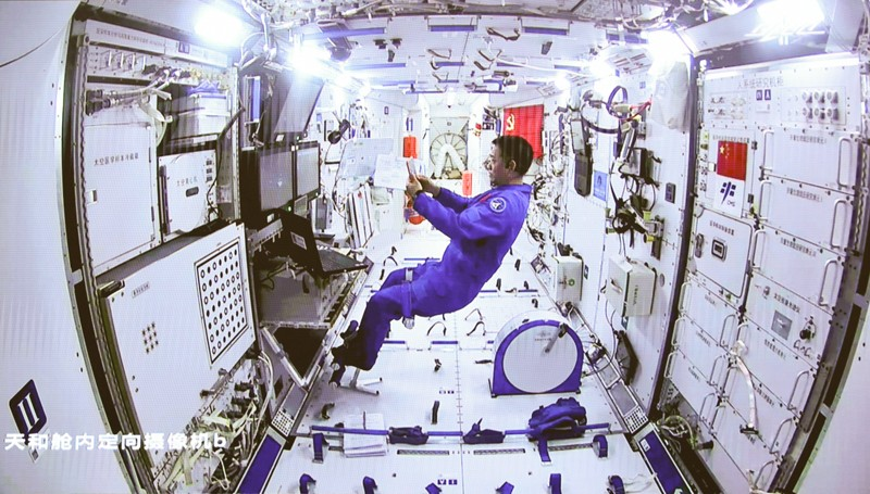 Chinese astronaut Nie Haisheng staying inside Tianhe space module