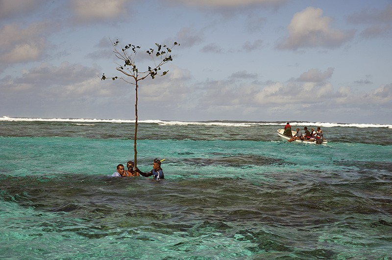 Customary fishing-rights holders from Totoya Island, Fiji, marking a sacred reef area as a no-fishing zone.Credit: Keith Ellenbogen