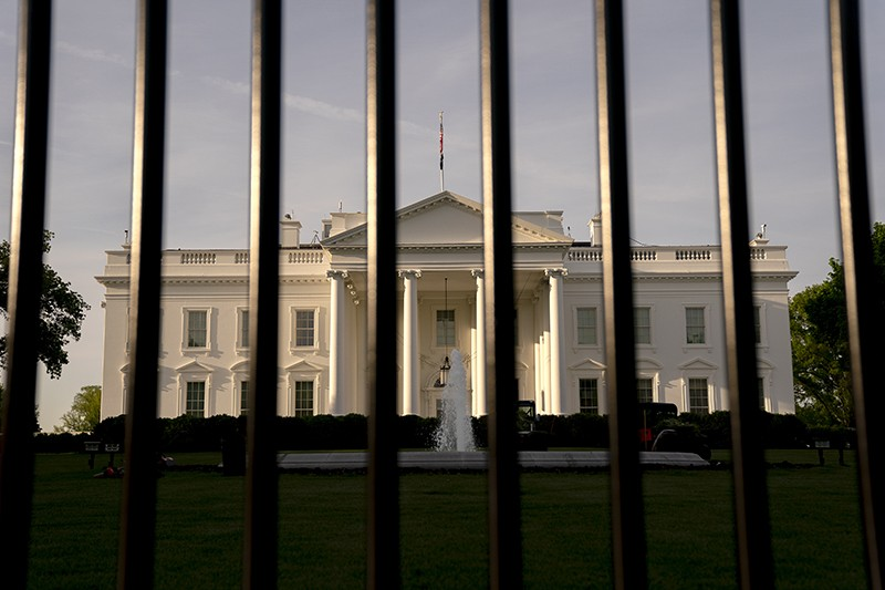 The Presidential White House behind security fencing in Washington, D.C., US.