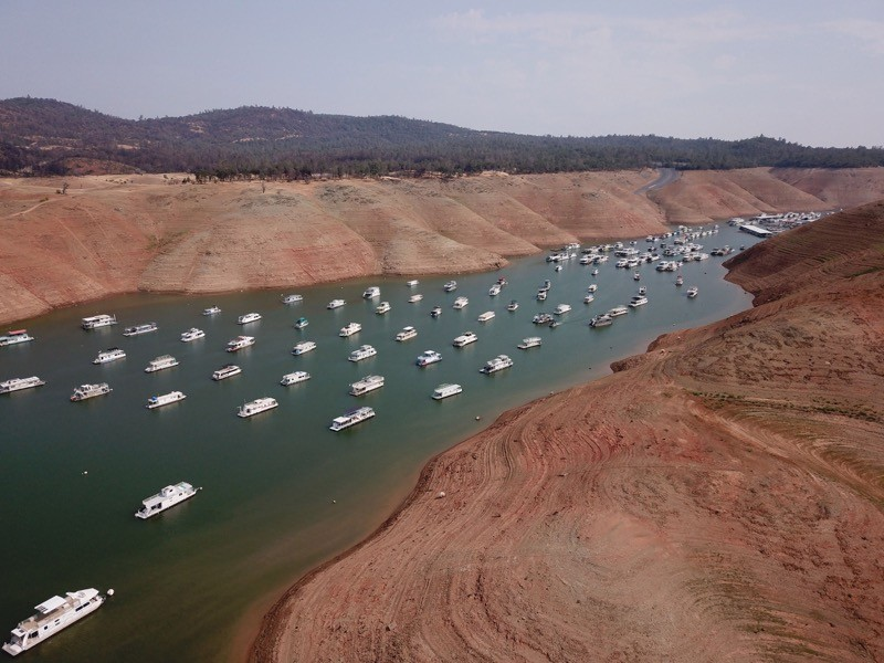 In this aerial photo houseboats sit in low water on Lake Oroville as California's drought emergency worsens.