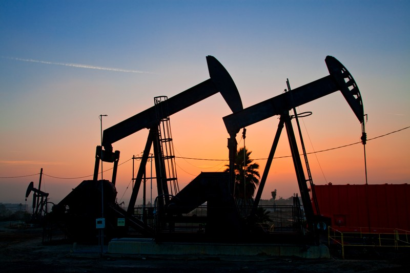 Hydraulic fracturing pumps at sunset