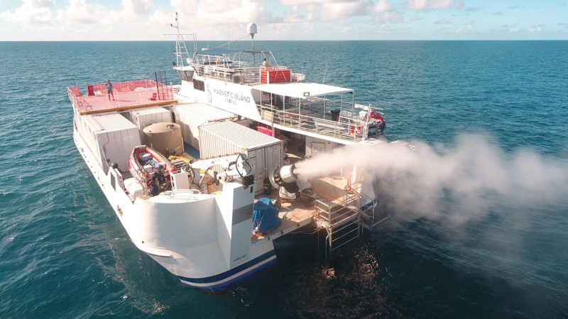 A boat using the sea-spraying cloud brightening system over the Great Barrier Reef in Australia during a 2021 trial.