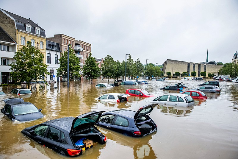 Cars are seen floating in a flooded street in Valkenburg, Netherlands.