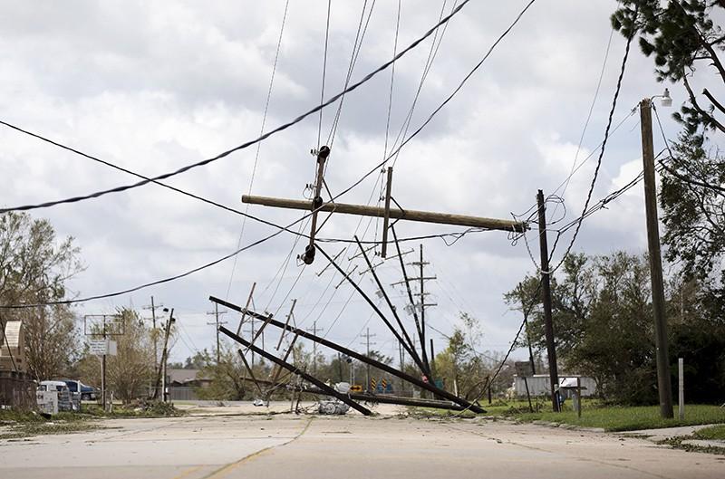 Power-line poles fallen across a street.