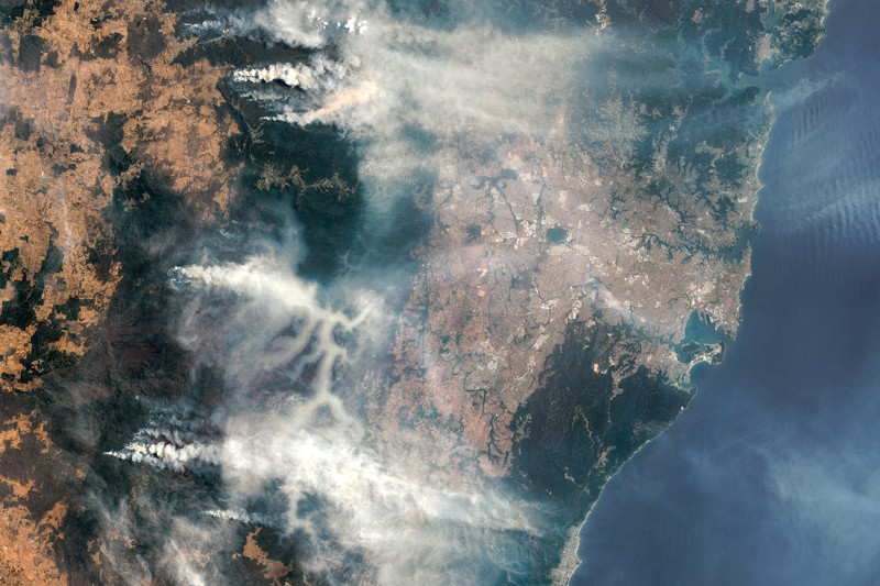 Satellite image of Australia showing huge clouds of smoke blowing from bush fires east towards Sydney.