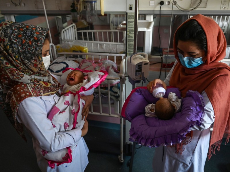 Nurses feed newborn babies rescued and brought to Ataturk Children hospital, Kabul, May 2020.