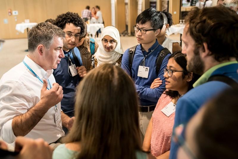 Nobel Konstantin Novoselov talks to a group of young scientists.