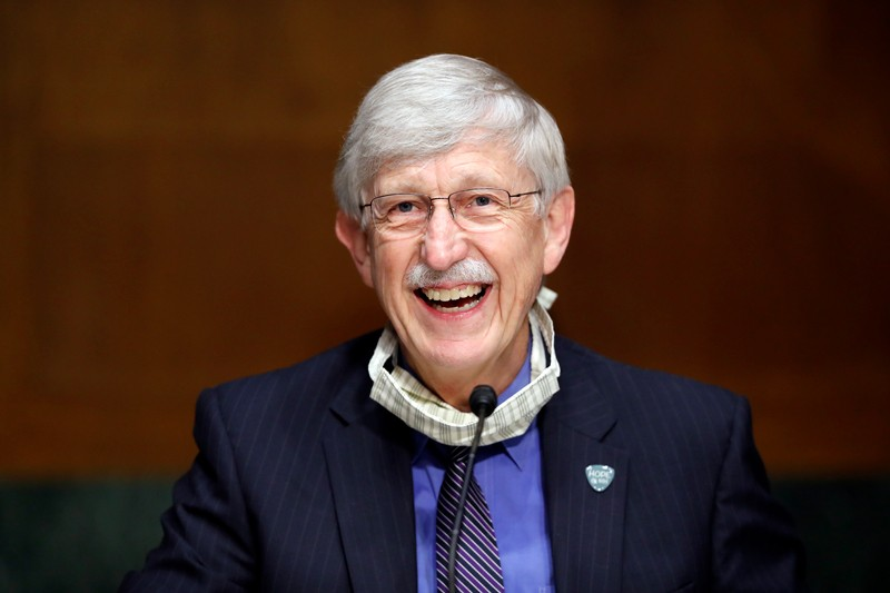 Dr. Francis Collins smiles as he speaks during a hearing