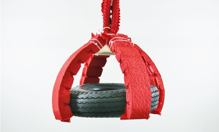 Artificial muscles lift rubber tire