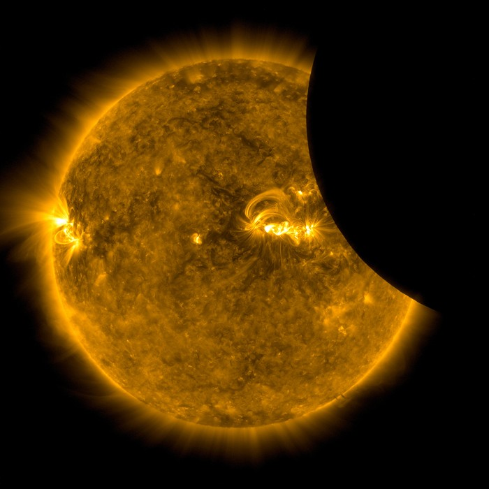 Image of the Moon transiting across the Sun in extreme ultraviolet light