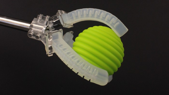 Soft robotic gripper holding a ball