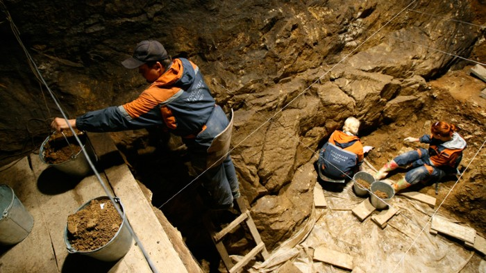 Archaeologists working at an excavation at the Denisova Cave