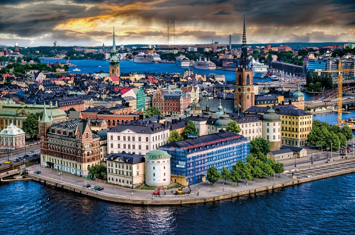 Photograph of varied and colourful buildings by the water in Stockholm.
