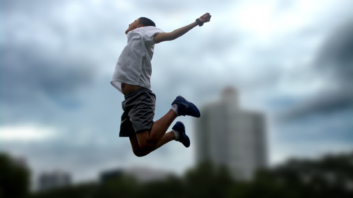 Young boy jumping in the air