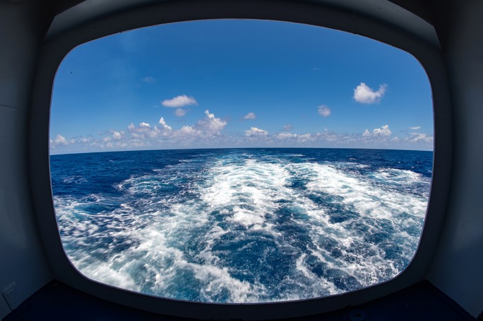 A view from the back of the freighter and cruise ship Aranui 5 as it sails in the Pacific Ocean.