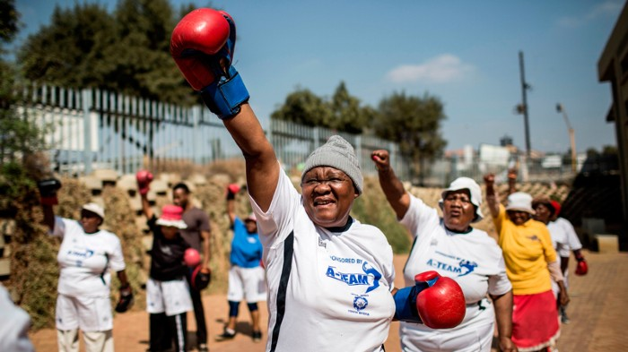 Grandmothers take part in a boxing training session