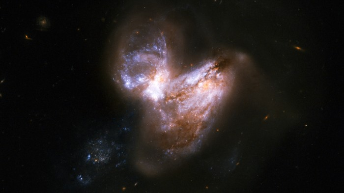 The system known as Arp 299 which consists of a pair of galaxies