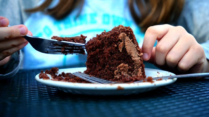 Eating chocolate cake with a fork