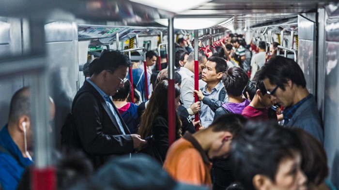 Commuters packed on an underground train in Hong Kong