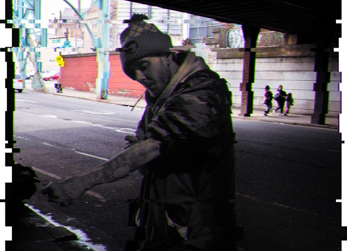 A drug addict injecst himself in the street in Philadelphia
