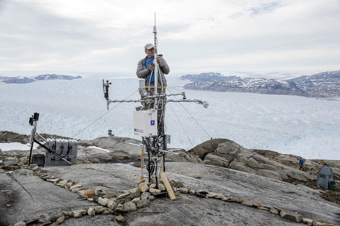Researcher repairs GPS module near glacier