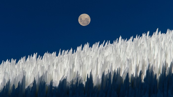 Columns of compact snow called Nieve penitente with moon