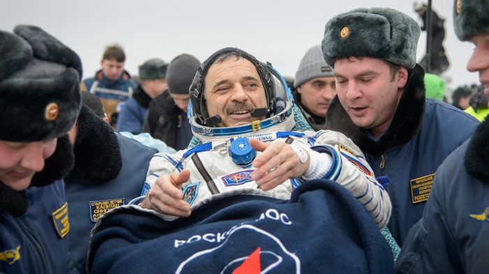 Russian cosmonaut Mikhail Kornienko returning from a year-long mission in space