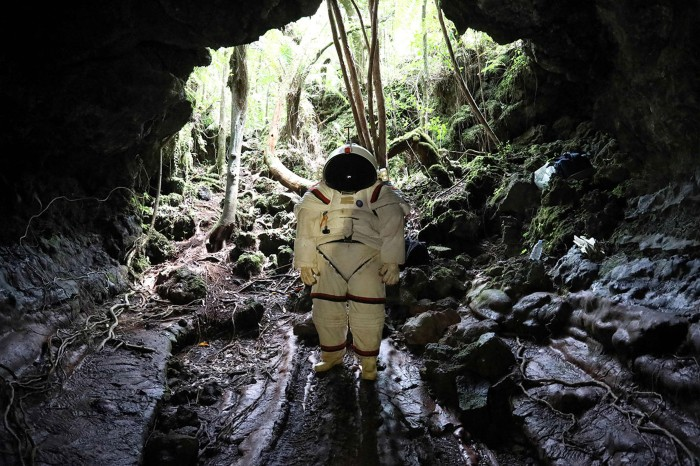 Peter Weiss, director of the Space Department of COMEX, tests a pressurized suit in a lava tunnel