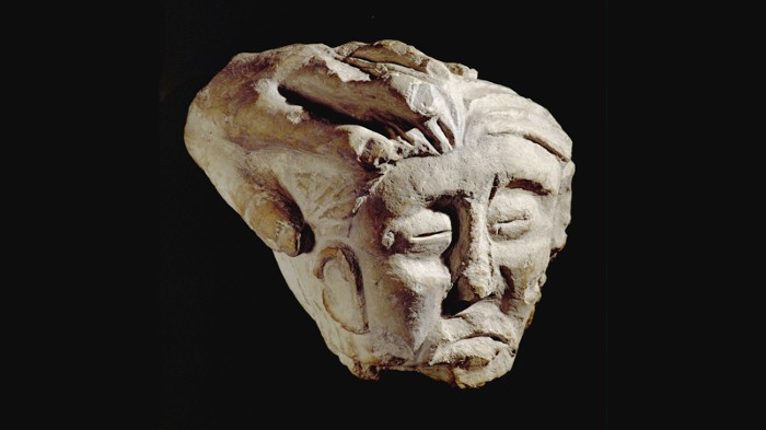 Celtic sculpture of a beheaded head, held by a hand