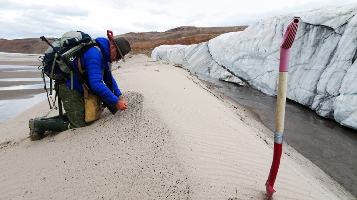 collecting sand samples at the front of Hiawatha Glacier
