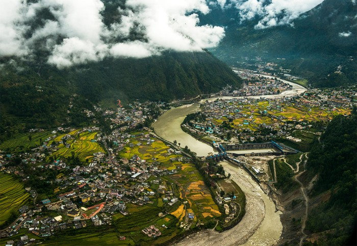 Aerial view of Tehri dam with the winding Ganges river, mountains and villages