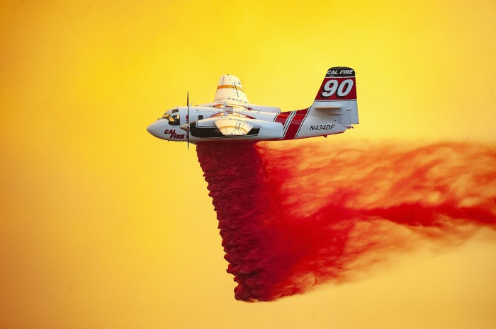 A plane drops fire retardant to help stop the spread of the River Fire burning in California.