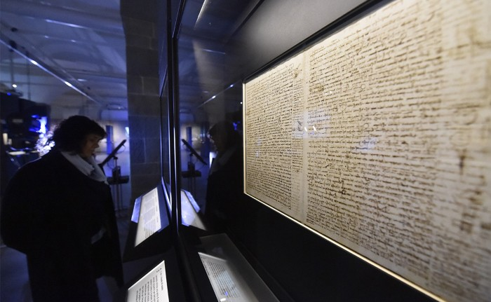 A woman looks at da Vinci's Codex Leicester at the exhibition