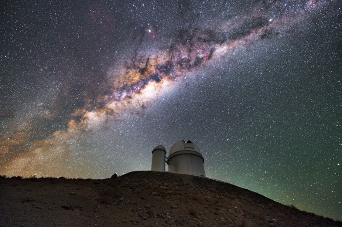 The Milky Way is seen above the ESO 3.6-metre telescope at La Silla