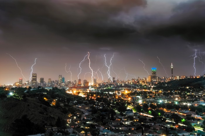 A thunderstorm rolls across the city of Johannesburg sending a multitude of forked lightning strikes into the city centre.